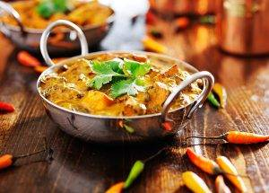 traditional Indian curry on table with chillies